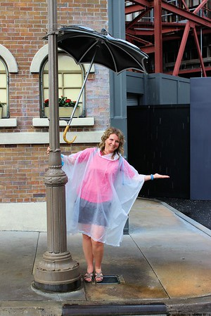 I was wearing my authentic Disney poncho. &  I was singing in the rain.....