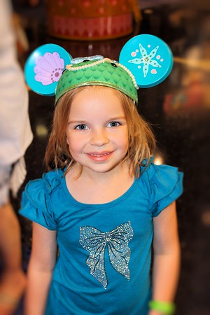 When ever we go to Disney we have to take pictures with all the cool Mickey ears.  Here is Makenna with the Little Mermaid ears.