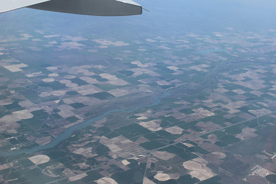 Enjoyed all the circles  & squares in the landscape below the plane.