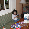 Evelyn reading Disney Magazine in living room at Beach Club Villas