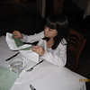 Evelyn admiring the napkin folding