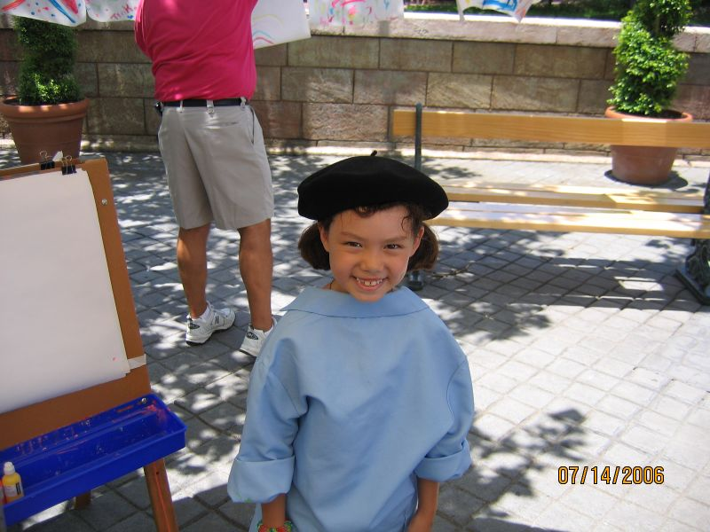 Evelyn getting ready to make a mess in Epcot's France pavilion.