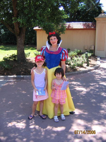 Evelyn and Heather posing with Snow White.<br /> <br /> This picture is taken between Morocco and United States pavilions in Epcot.