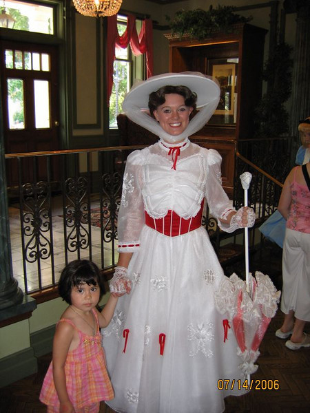 Heather looking cheerful with Mary Poppins.<br /> <br /> This picture is taken at the England pavilion in Epcot.