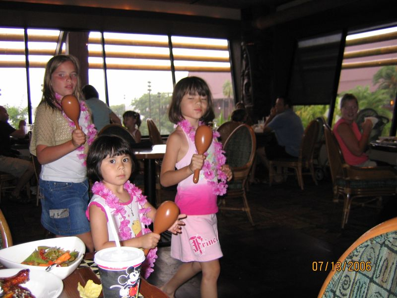 Heather and Evelyn playing the maracas at 'Ohana in Disney's Polynesian Resort.