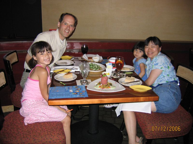 Picture of the entire family at Jiko in Disney's Animal Kingdom Lodge.<br /> <br /> The mound of food in the foreground is a tuna tartare.  Behind that is a flatbread.