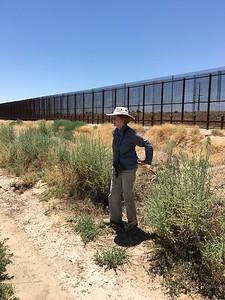 Anne at the Border Wall @ Rio Bosque Wetlands Park
