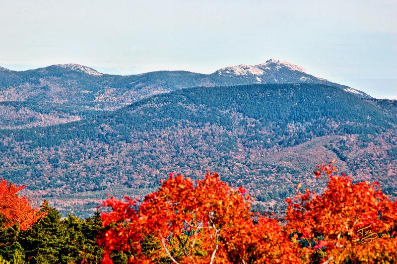 Kancamagus Highway - Scenic Rest Area a splash of Autumn colors adorn Mount Chocorua