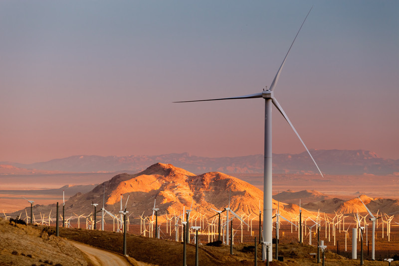 Sunset view of a group of windmills in California, providing alternative energy to the state.
