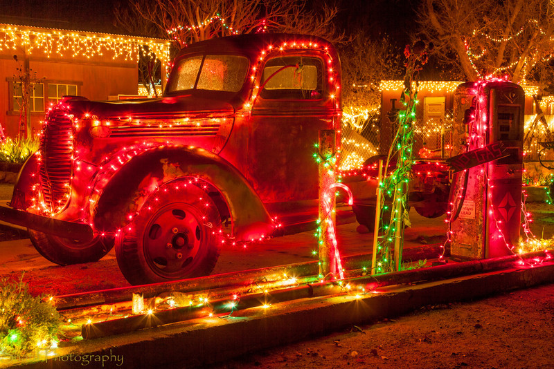 Vintage car in Christmas decoration<br /> A vintage car is decorated with lights on the side of the road in Bradley. The start of our road trip!