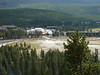This is a zoomed in image from the mountain looking down at Old Faithfull.