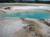The hot spring pools are this wonder shade of blue from the reflected sun light on the minerals in the water.