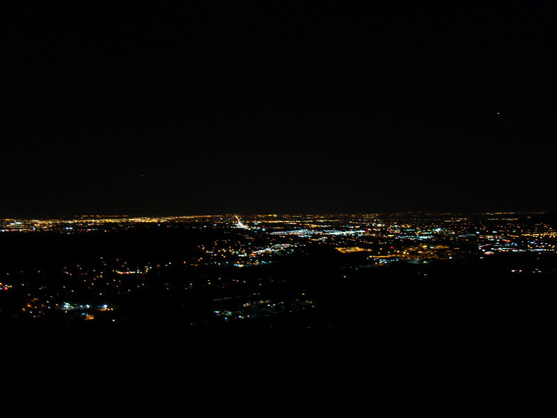 This is the view of Denver at night from a lookout point on a mountain behind Golden Co.