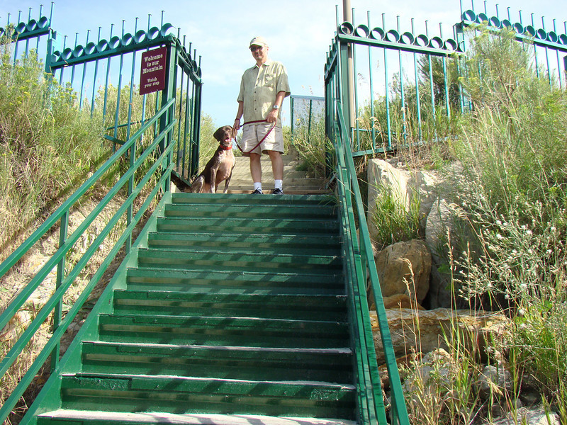 Dutchess and I standing on the stairs to a small hill that overlooks the RV park.