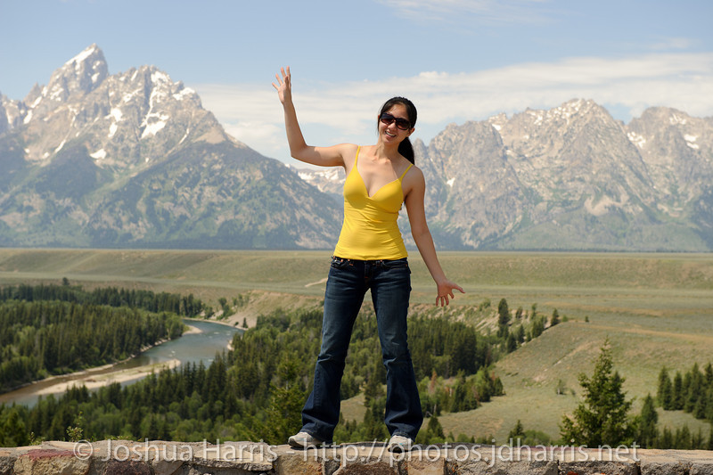 Connie striking a pose in front of the Grand Teton mountains
