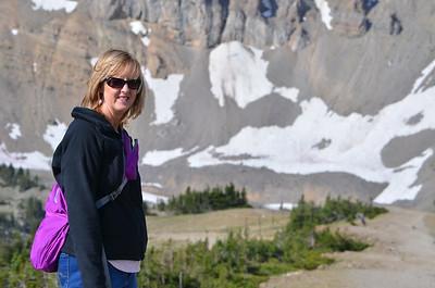 Kathy walking down peak of Jackson Hole - to get some snow.