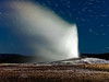 Old Faithful geyser at night