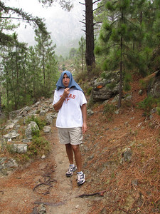 It started pouring raining on our hike back (about 2 hours in the rain)- so Richard improvised using a towel as rain gear.