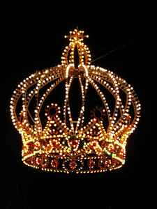 A salute to Napoleon who was born in Ajaccio. A lighted crown hanging above the street.