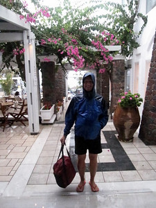 Enjoying the rain (with beach bag..... never hurts to be optimistic).