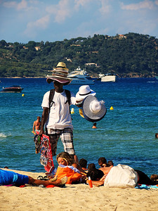 In the St. Tropez sun - a hat is advisable  - but isn't wearing one enough?