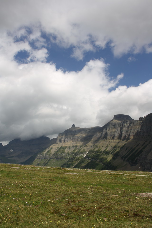 Glacier Park - Logan Pass structures.  The mountains have their own names, but the look of these also has a name, The Garden Wall, named by earlier visitors.   8-2009