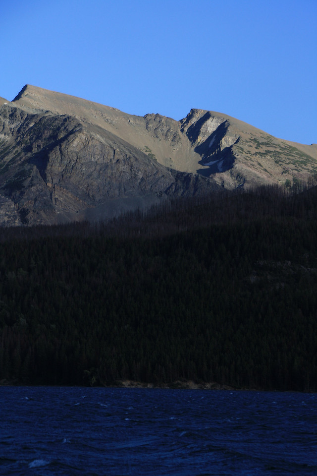 Glacier Park, MT.  View of mountain other side of Swiftcurrent Lake across the road from Swiftcurrent Motor Inn parking lot.  8-2009