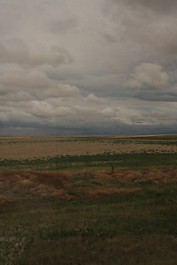 BNSF Amtrak train, view of Montana, rainey day.  8-16-09.