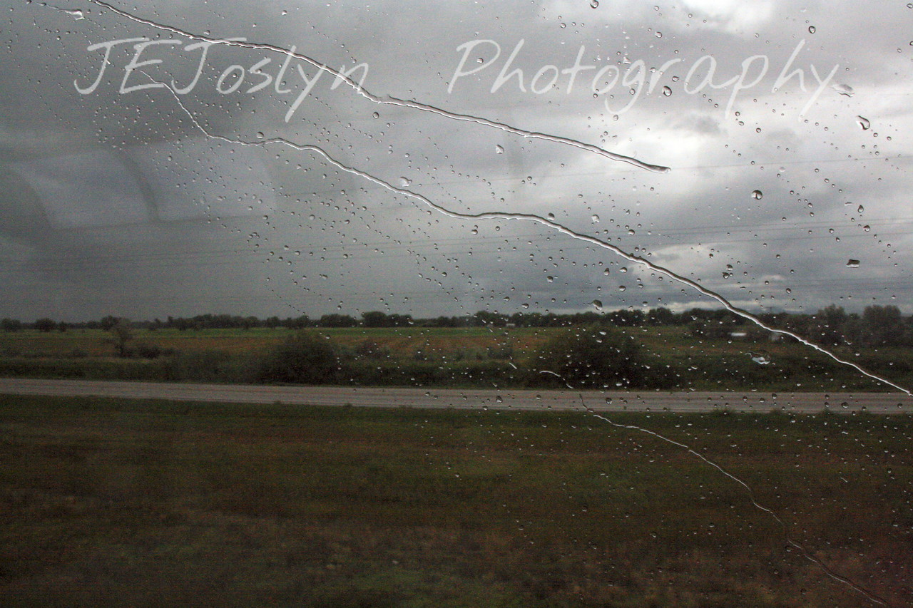 Amtrak, east bound, probably somewhere in eastern Montana.  Rain storms, there were many little showers, some with thunder, most of the afternoon.  8-16-09.