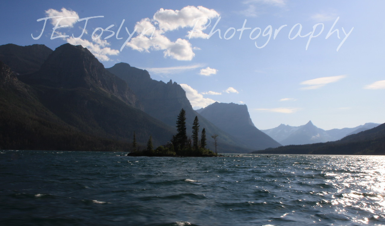 Glacier Park. St. Mary's Lake, Wild Goose Island, from Boat tour.  Mountains, 3rd from left Fusillade Mountain   8-2009