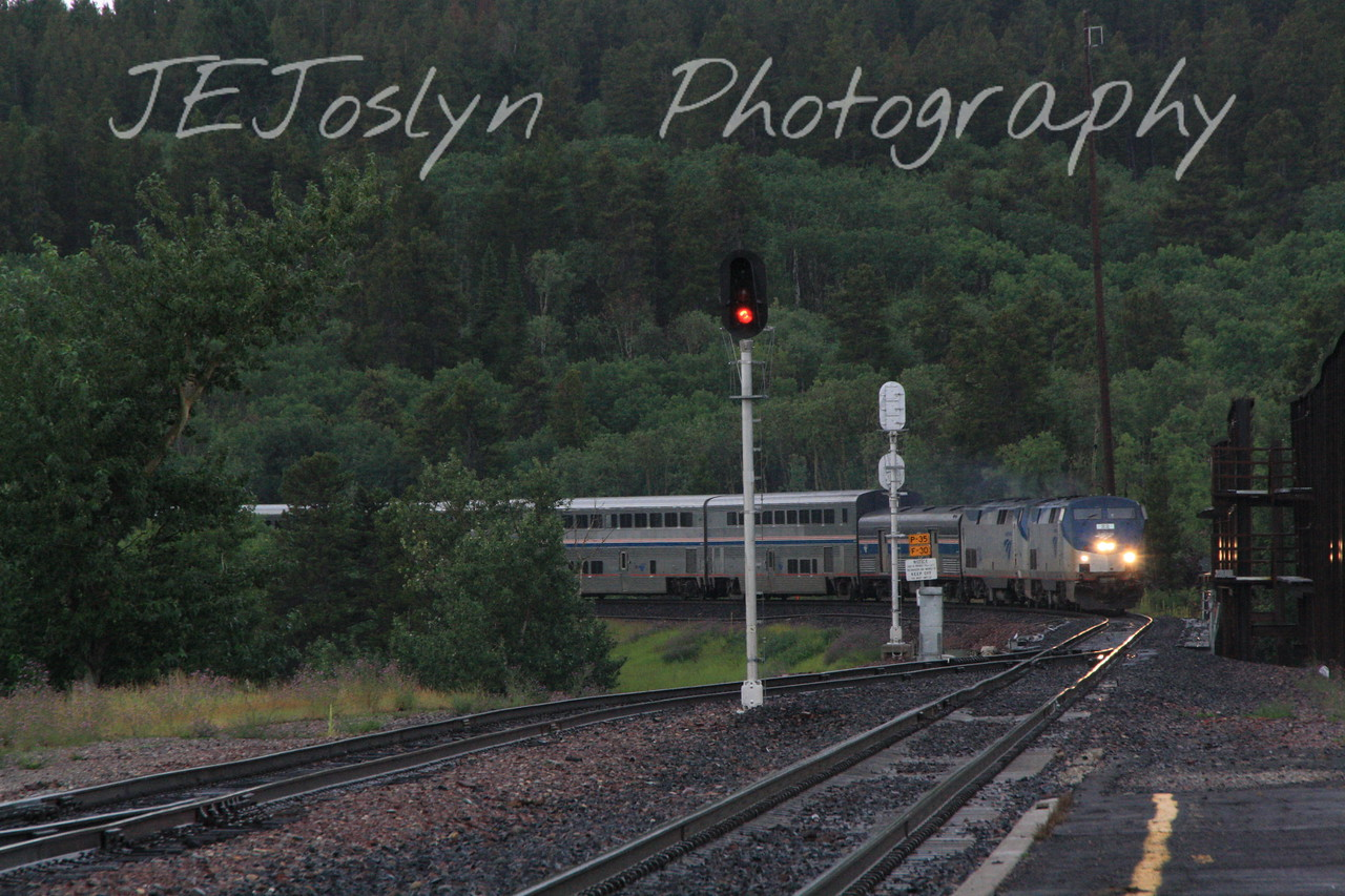 BNSF Amtrak train coming to East Glacier Park, MT depot, from the West.  8-16-09.