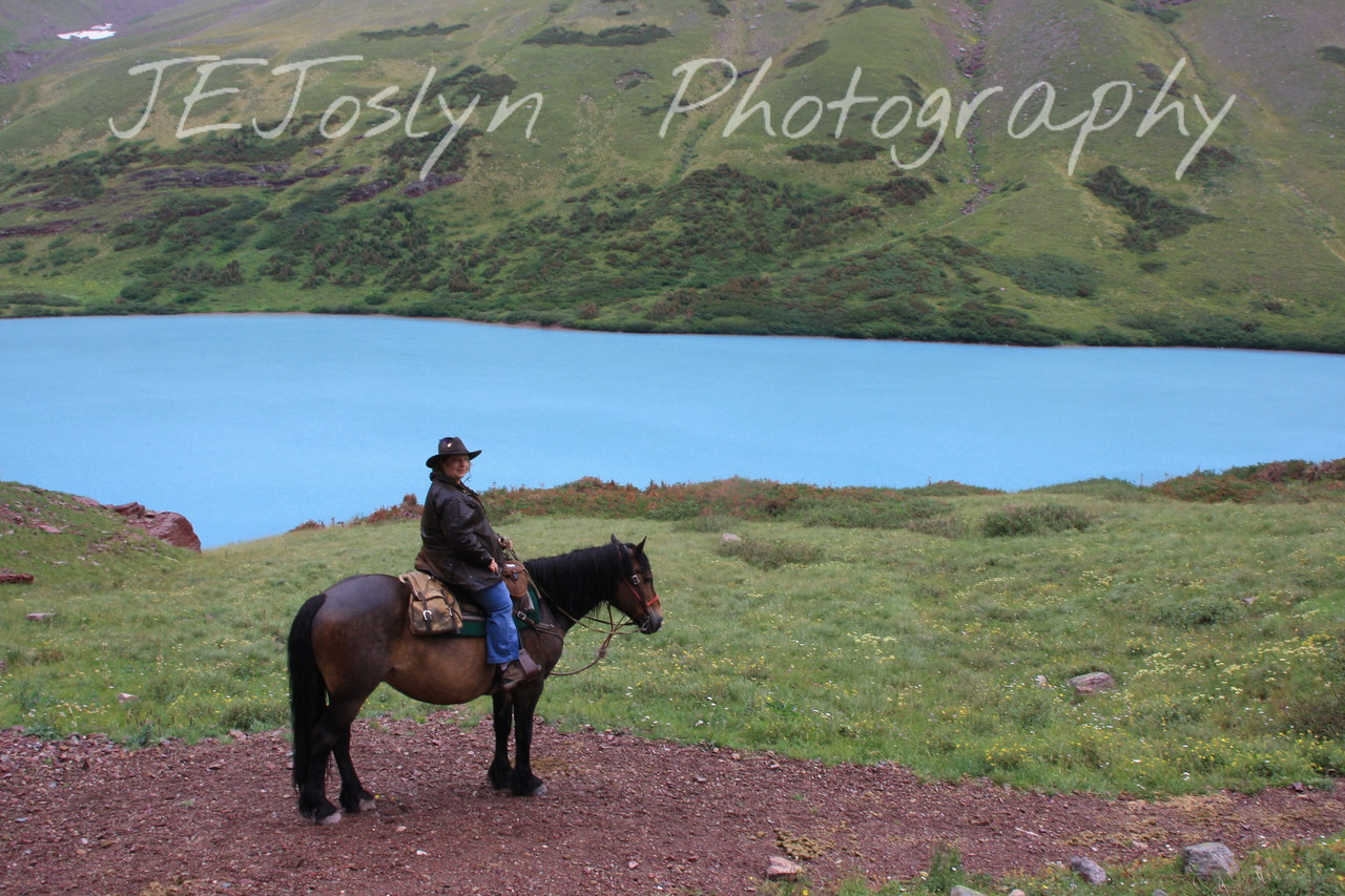 Glacier Park, MT.  This is SNIP.  The horse I rode 6.5 miles to Cracker Lake, and this great view.  Cracker Lake is located on the crater side of Siyeh Mountain.  Rained half of the day.  8-2009