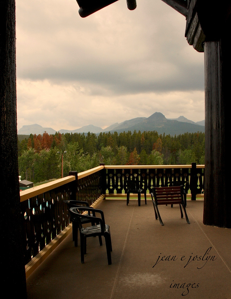 Glacier Park Lodge-East Glacier, Montana, on outside deck - haze is forest fire smoke, probably from Canada, 8-2009.