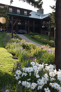 Glacier Park Lodge-East Glacier, Montana.  Gardens, perfectly maintained, went from the front door of this Lodge, that is what you see at the top of this garden and sidewalk.  8-2009