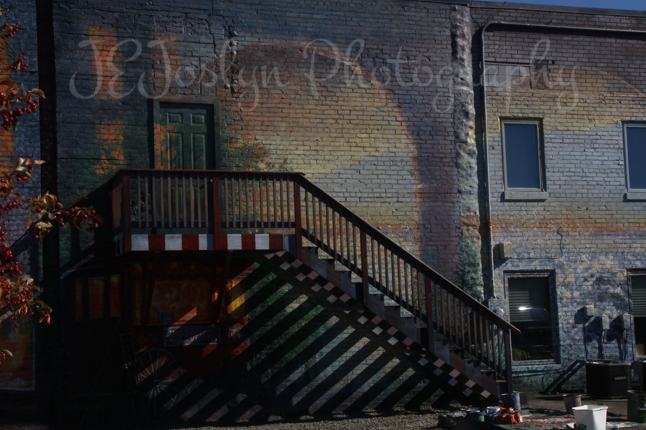 Various places I found in International Falls, an artist painting scenes on sides of building.