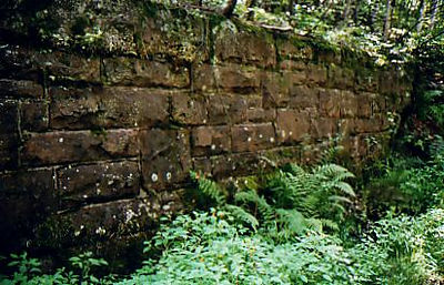 Man made wall on trail.