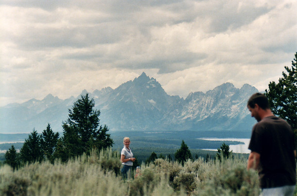 "Comments made during this photo opportunity, were by my son, ""Well, here's my wife and chirdren, out there playng in the tundra just waiting for bears!""  The Grand Tetons from Signal Hill."