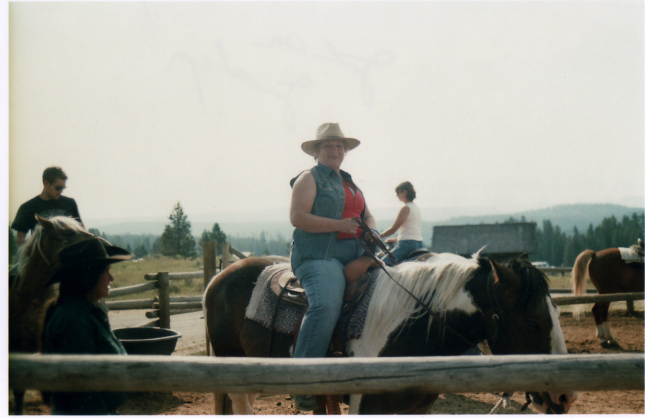 Me, and horse TatorTot, going riding our of a stable near Canyon, a settlement in the middle of Yellowstone National Park.  What a wonderful two hour ride.  Saw one buffalo - the heat kept all animals, except crazy adventurers, under cover until night and cooler air.  But we loved it.