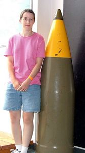 Ellen showing how big the shells are that the battleship would shoot!