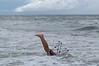 tom dunked in ocean feet up