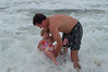 tom holding lauren in the waves