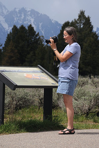 Deanna Taking a Picture of the Grand Tetons
