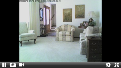 Living room in Madison as seen on my iPhone from my security cam while in Hawaii,  I have cams set up in each room so I can keep track of my cats.