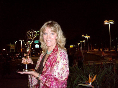 Andy holding an Emmy