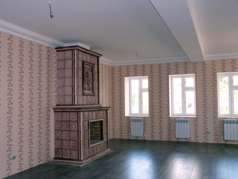 Interior of a home Oleg's renovating with a traditional Russian stove.