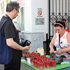 Rustem buying wild strawberries on the street in Yaroslavl.