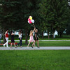 Girl with balloons out for a walk.