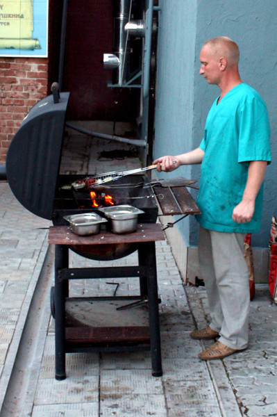 Dima barbecuing dinner for us in Vyatskoe's backyard on our 20th anniversary.