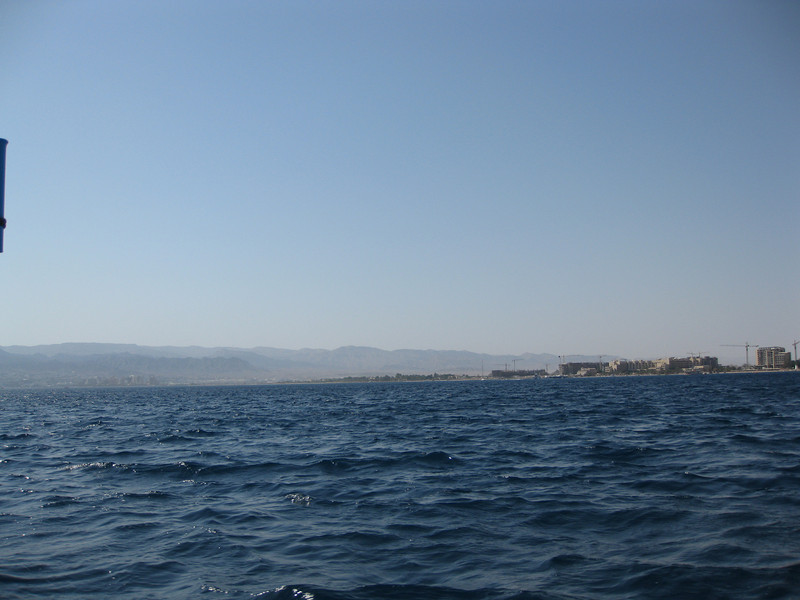 On the right is Aqaba. On the left is Eilat (Israel). To the far left is Egypt and to the far right is Saudi Arabia. The Jordanian coastline is only 20Km or so in length. Four countries in a very small stretch of land.