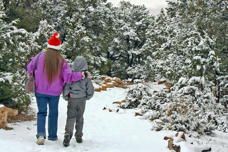 Mother & son walking through the Tusayan Pueblo ruins.